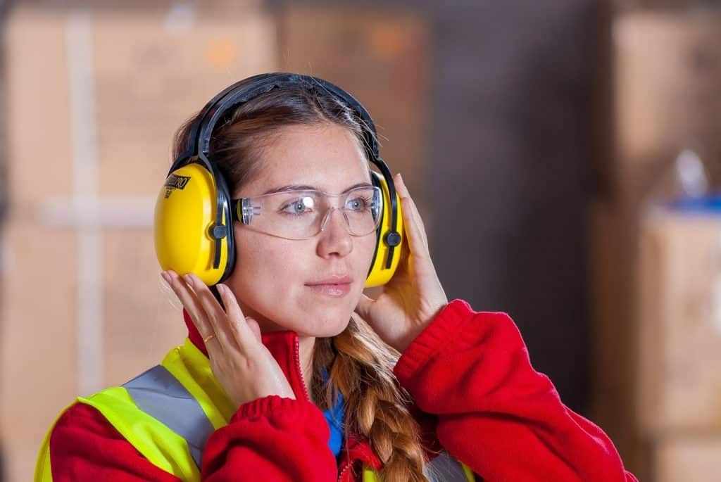 A woman using proper PPE for workplace safety